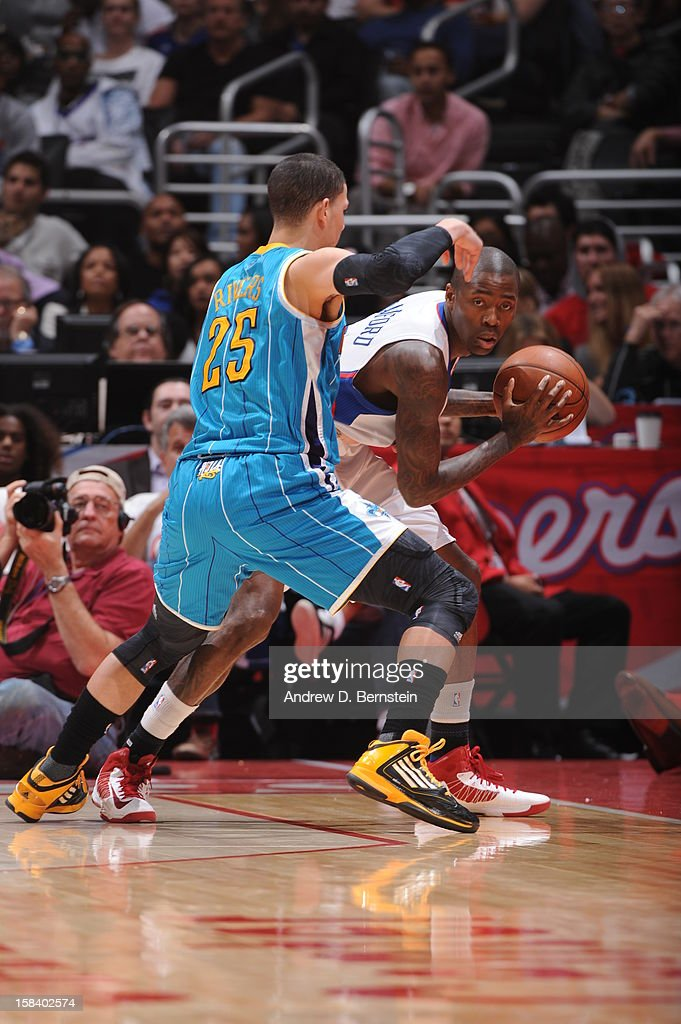<a gi-track='captionPersonalityLinkClicked' href=/galleries/search?phrase=Jamal+Crawford&family=editorial&specificpeople=201851 ng-click='$event.stopPropagation()'>Jamal Crawford</a> #11 of the Los Angeles Clippers controls the ball against <a gi-track='captionPersonalityLinkClicked' href=/galleries/search?phrase=Austin+Rivers&family=editorial&specificpeople=7117574 ng-click='$event.stopPropagation()'>Austin Rivers</a> #25 of the New Orleans Hornets at Staples Center on November 26, 2012 in Los Angeles, California.