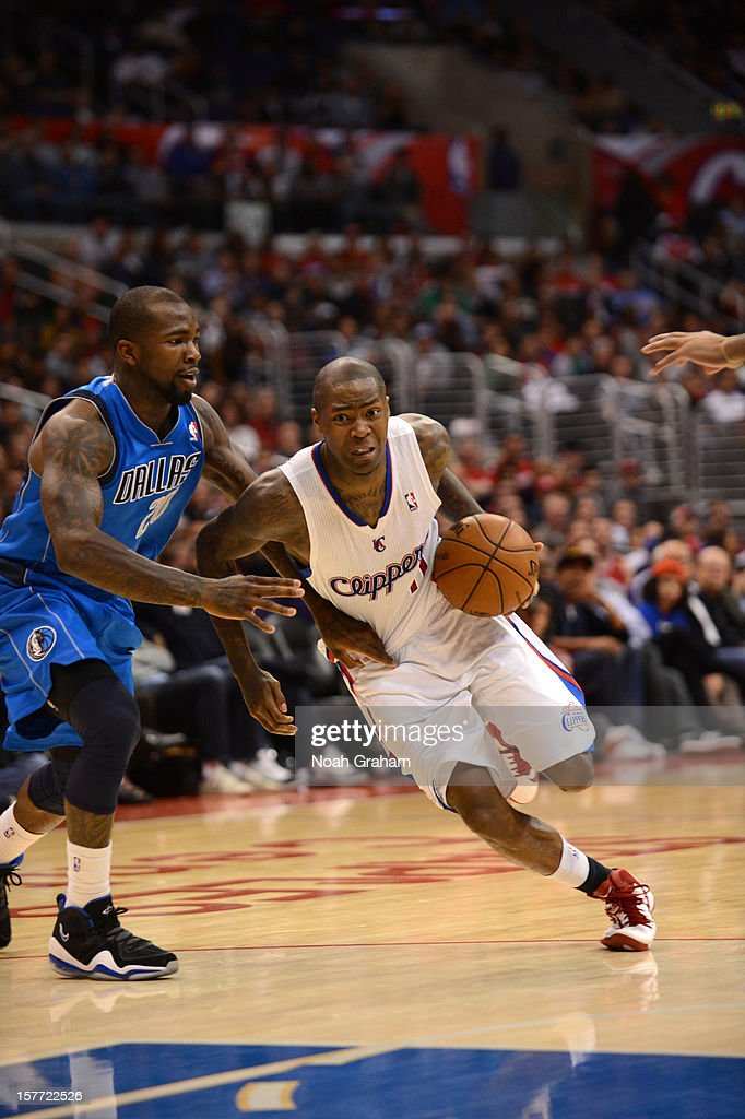 <a gi-track='captionPersonalityLinkClicked' href=/galleries/search?phrase=Jamal+Crawford&family=editorial&specificpeople=201851 ng-click='$event.stopPropagation()'>Jamal Crawford</a> #11 of the Los Angeles Clippers drives against <a gi-track='captionPersonalityLinkClicked' href=/galleries/search?phrase=Dominique+Jones+-+Basketball+Player&family=editorial&specificpeople=4782614 ng-click='$event.stopPropagation()'>Dominique Jones</a> #20 of the Dallas Mavericks during the game between the Los Angeles Clippers and the Dallas Mavericks at Staples Center on December 5, 2012 in Los Angeles, California.