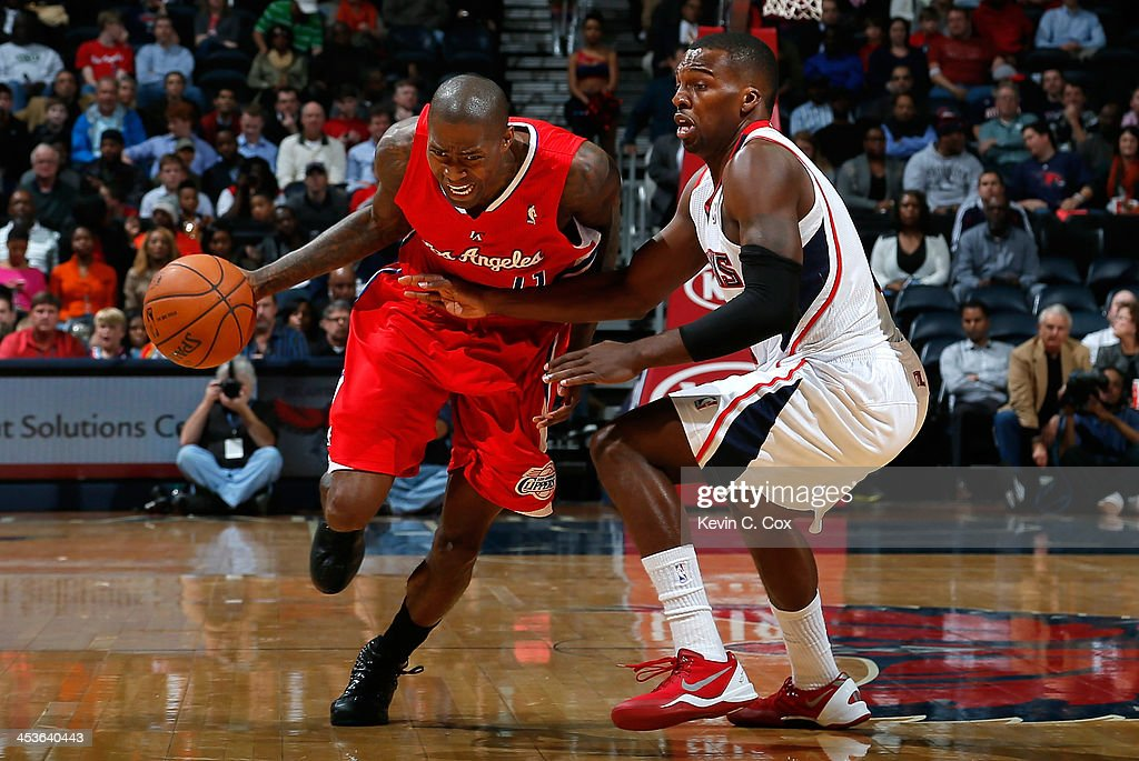 <a gi-track='captionPersonalityLinkClicked' href=/galleries/search?phrase=Jamal+Crawford&family=editorial&specificpeople=201851 ng-click='$event.stopPropagation()'>Jamal Crawford</a> #11 of the Los Angeles Clippers drives against <a gi-track='captionPersonalityLinkClicked' href=/galleries/search?phrase=Shelvin+Mack&family=editorial&specificpeople=5767272 ng-click='$event.stopPropagation()'>Shelvin Mack</a> #8 of the Atlanta Hawks at Philips Arena on December 4, 2013 in Atlanta, Georgia.