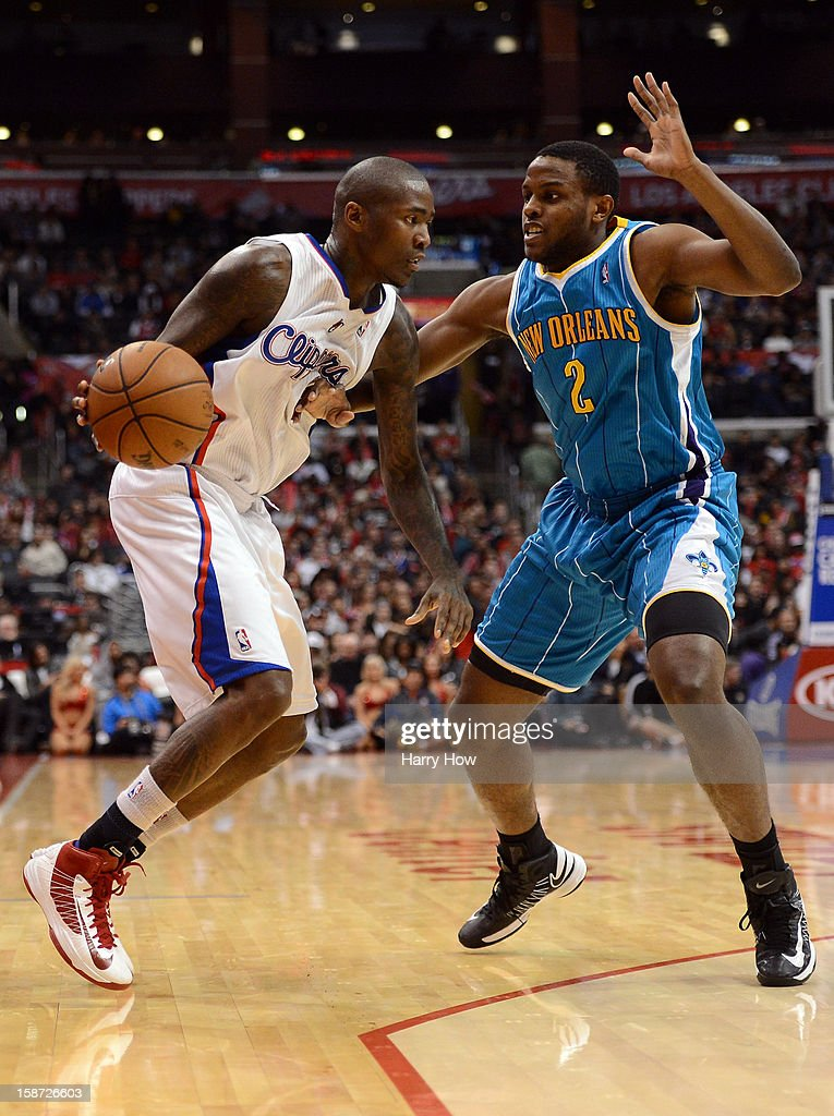 Jamal Crawford #11 of the Los Angeles Clippers drives on Darius Miller #2 of the New Orleans Hornets during a 93-77 Clipper victory for their 11th straight win at Staples Center on December 19, 2012 in Los Angeles, California.