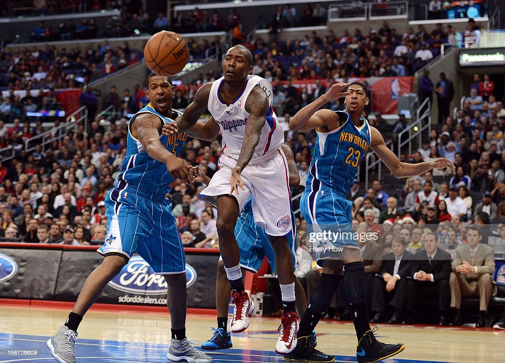 Jamal Crawford #11 of the Los Angeles Clippers drives on Dominic McGuire #5 and Anthony Davis #23 of the New Orleans Hornets during a 93-77 Clipper victory for their 11th straight win at Staples Center on December 19, 2012 in Los Angeles, California.