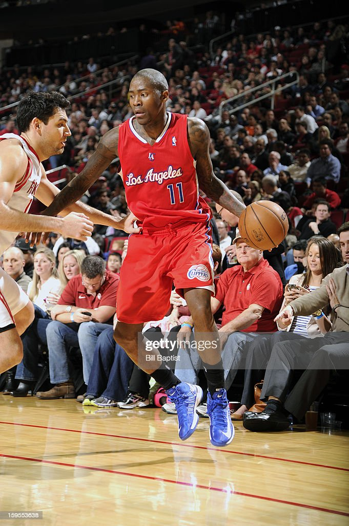 Jamal Crawford #11 of the Los Angeles Clippers drives the ball against Carlos Delfino #10 of the Houston Rockets on January 15, 2013 at the Toyota Center in Houston, Texas.