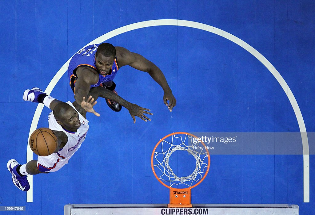 <a gi-track='captionPersonalityLinkClicked' href=/galleries/search?phrase=Jamal+Crawford&family=editorial&specificpeople=201851 ng-click='$event.stopPropagation()'>Jamal Crawford</a> #11 of the Los Angeles Clippers drives to the basket on <a gi-track='captionPersonalityLinkClicked' href=/galleries/search?phrase=Serge+Ibaka&family=editorial&specificpeople=5133378 ng-click='$event.stopPropagation()'>Serge Ibaka</a> #9 of the Oklahoma City Thunder at Staples Center on January 22, 2013 in Los Angeles, California.