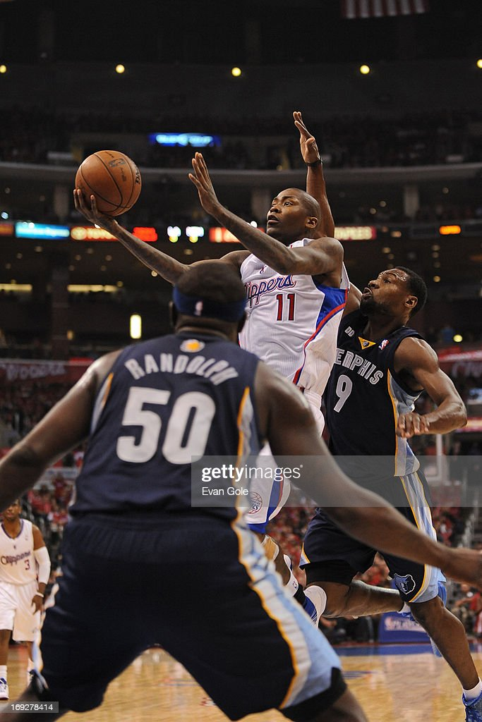 <a gi-track='captionPersonalityLinkClicked' href=/galleries/search?phrase=Jamal+Crawford&family=editorial&specificpeople=201851 ng-click='$event.stopPropagation()'>Jamal Crawford</a> #11 of the Los Angeles Clippers drives to the basket against the Memphis Grizzlies at Staples Center in Game One of the Western Conference Quarterfinals during the 2013 NBA Playoffs on April 20, 2013 in Los Angeles, California.