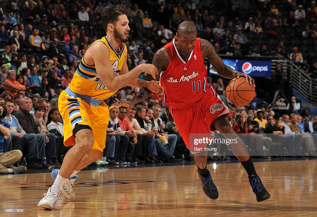 <a gi-track='captionPersonalityLinkClicked' href=/galleries/search?phrase=Jamal+Crawford&family=editorial&specificpeople=201851 ng-click='$event.stopPropagation()'>Jamal Crawford</a> #11 of the Los Angeles Clippers drives to the basket against the Denver Nuggets on February 3, 2014 at the Pepsi Center in Denver, Colorado.