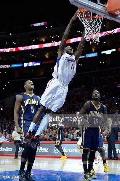 Jamal Crawford of the Los Angeles Clippers dunks between Lavoy Allen and Donald Sloan of the Indiana Pacers during a 102100 Clipper win at Staples...