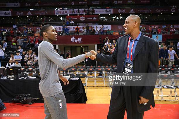 Jamal Crawford of the Los Angeles Clippers greets Jerome Williams as part of the 2015 NBA Global Games China at the Shenzhen Universiade Center on...