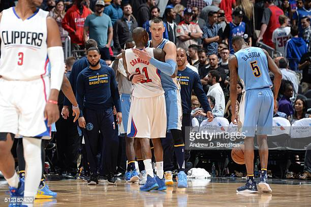 Jamal Crawford of the Los Angeles Clippers hugs Danilo Gallinari of the Denver Nuggets after the game on February 24 2016 at STAPLES Center in Los...
