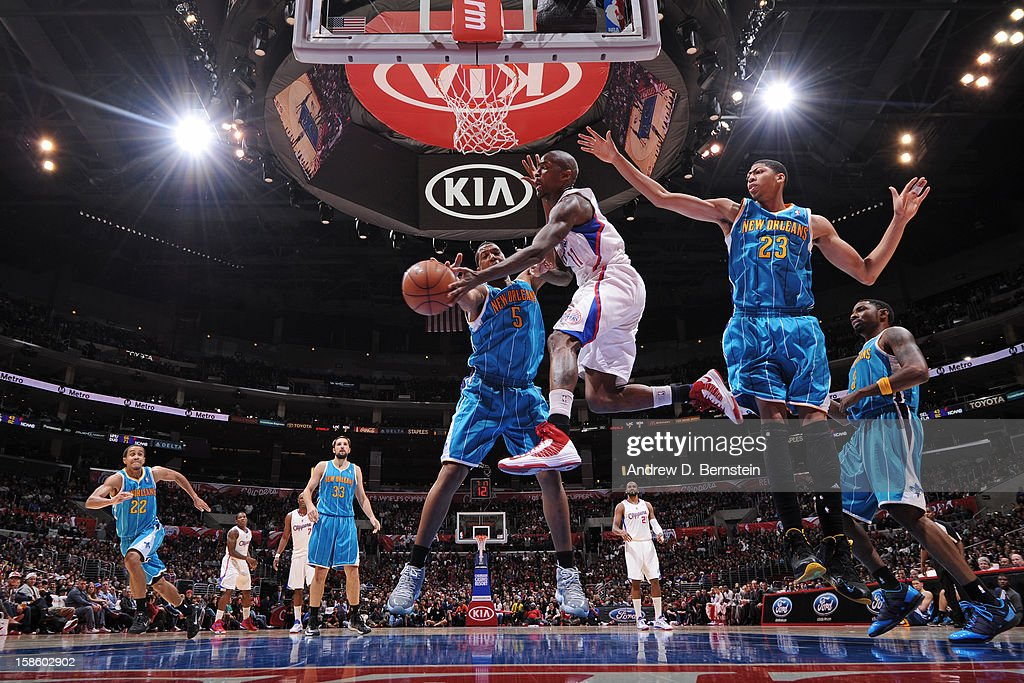 <a gi-track='captionPersonalityLinkClicked' href=/galleries/search?phrase=Jamal+Crawford&family=editorial&specificpeople=201851 ng-click='$event.stopPropagation()'>Jamal Crawford</a> #11 of the Los Angeles Clippers makes a pass against <a gi-track='captionPersonalityLinkClicked' href=/galleries/search?phrase=Dominic+McGuire&family=editorial&specificpeople=2537986 ng-click='$event.stopPropagation()'>Dominic McGuire</a> #5 of the New Orleans Hornets at Staples Center on December 19, 2012 in Los Angeles, California.