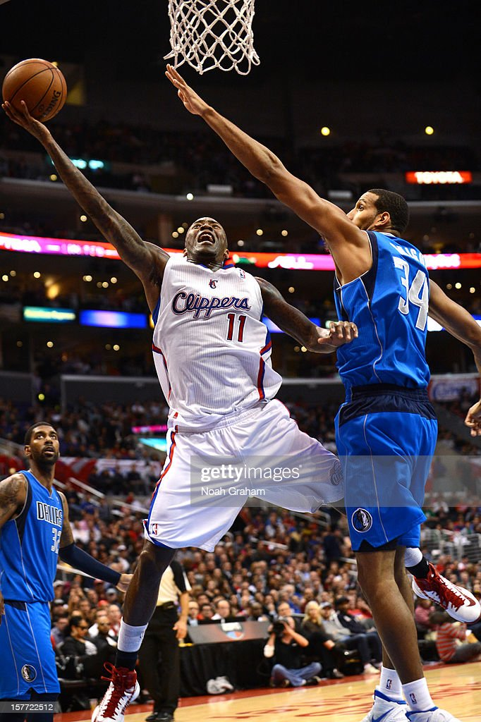 <a gi-track='captionPersonalityLinkClicked' href=/galleries/search?phrase=Jamal+Crawford&family=editorial&specificpeople=201851 ng-click='$event.stopPropagation()'>Jamal Crawford</a> #11 of the Los Angeles Clippers protects the ball from <a gi-track='captionPersonalityLinkClicked' href=/galleries/search?phrase=Brandan+Wright&family=editorial&specificpeople=3847557 ng-click='$event.stopPropagation()'>Brandan Wright</a> #34 of the Dallas Mavericks during the game between the Los Angeles Clippers and the Dallas Mavericks at Staples Center on December 5, 2012 in Los Angeles, California.