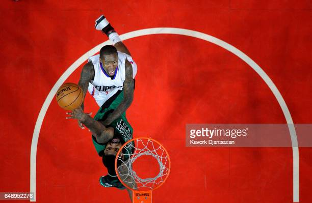 Jamal Crawford of the Los Angeles Clippers scores a basket against Amir Johnson of the Boston Celtics during the secone half of the basketball game...