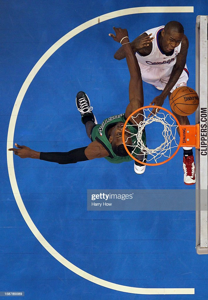Jamal Crawford #11 of the Los Angeles Clippers scores on a layup by Jeff Green #8 of the Boston Celtics during a 106-77 Clippers victory for 15 straight wins at Staples Center on December 27, 2012 in Los Angeles, California.