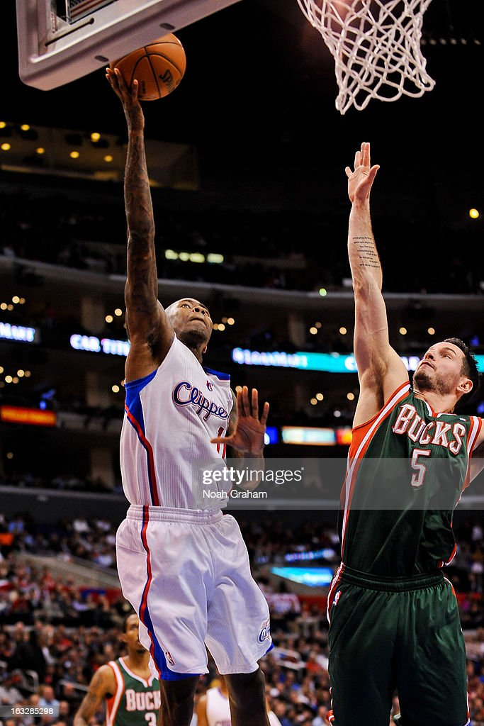 Jamal Crawford #11 of the Los Angeles Clippers shoots a layup against J.J. Redick #5 of the Milwaukee Bucks at Staples Center on March 6, 2013 in Los Angeles, California.