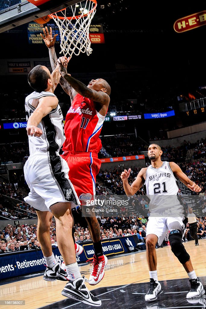 Jamal Crawford #11 of the Los Angeles Clippers shoots a layup against Manu Ginobili #20 of the San Antonio Spurs on November 19, 2012 at the AT&T Center in San Antonio, Texas.