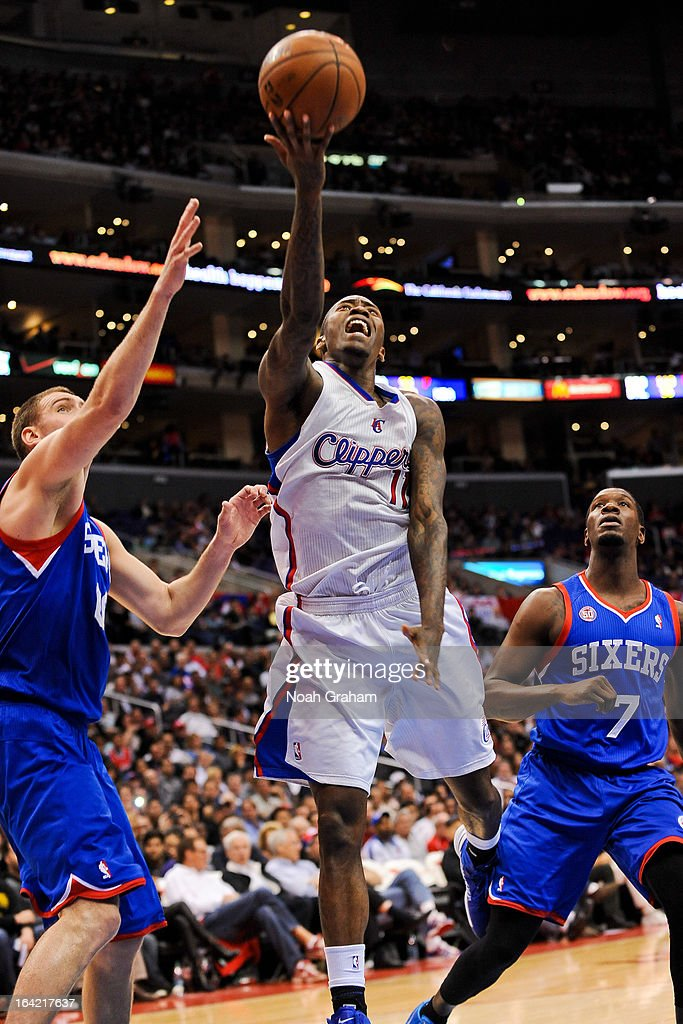 Jamal Crawford #11 of the Los Angeles Clippers shoots a layup against Spencer Hawes #00 of the Philadelphia 76ers at Staples Center on March 20, 2013 in Los Angeles, California.