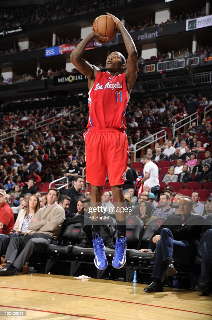Jamal Crawford #11 of the Los Angeles Clippers shoots a three pointer against the Houston Rockets on January 15, 2013 at the Toyota Center in Houston, Texas.