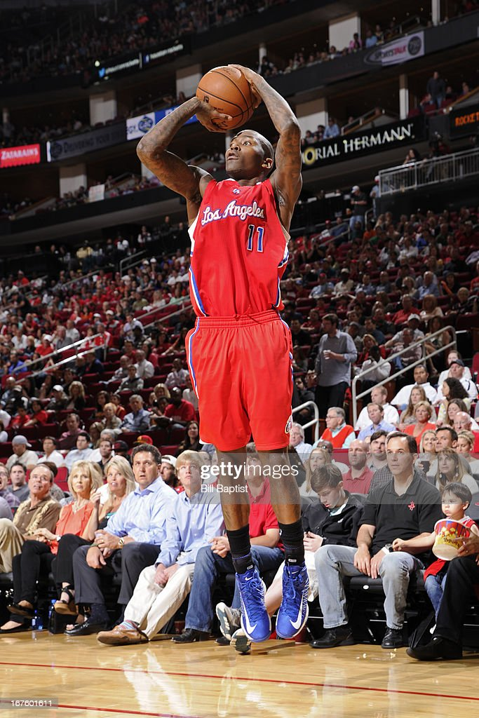 <a gi-track='captionPersonalityLinkClicked' href=/galleries/search?phrase=Jamal+Crawford&family=editorial&specificpeople=201851 ng-click='$event.stopPropagation()'>Jamal Crawford</a> #11 of the Los Angeles Clippers shoots a three pointer against the Houston Rockets on March 30, 2013 at the Toyota Center in Houston, Texas.