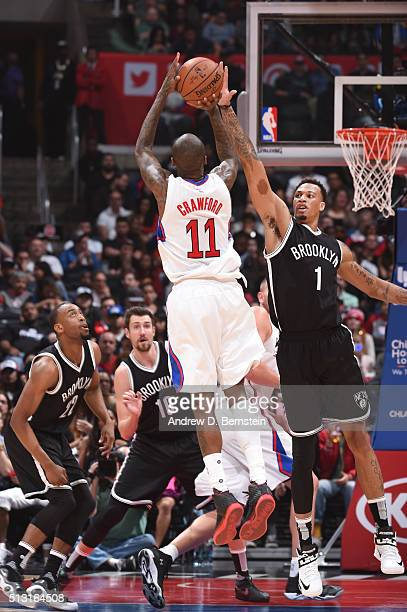 Jamal Crawford of the Los Angeles Clippers shoots against Chris McCullough of the Brooklyn Nets during the game on February 29 2016 at Staples Center...