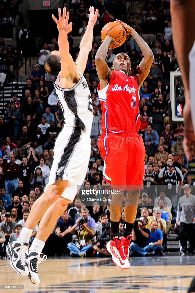 Jamal Crawford #11 of the Los Angeles Clippers shoots against Manu Ginobili #20 of the San Antonio Spurs on November 19, 2012 at the AT&T Center in San Antonio, Texas.