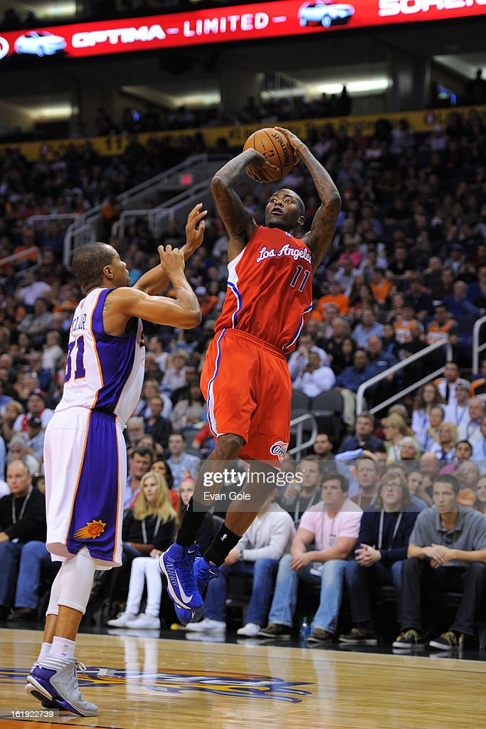<a gi-track='captionPersonalityLinkClicked' href=/galleries/search?phrase=Jamal+Crawford&family=editorial&specificpeople=201851 ng-click='$event.stopPropagation()'>Jamal Crawford</a> #11 of the Los Angeles Clippers shoots against <a gi-track='captionPersonalityLinkClicked' href=/galleries/search?phrase=Sebastian+Telfair&family=editorial&specificpeople=202087 ng-click='$event.stopPropagation()'>Sebastian Telfair</a> #31 of the Phoenix Suns at US Airways Center on January 24, 2013 in Phoenix, Arizona.