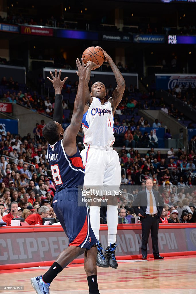 <a gi-track='captionPersonalityLinkClicked' href=/galleries/search?phrase=Jamal+Crawford&family=editorial&specificpeople=201851 ng-click='$event.stopPropagation()'>Jamal Crawford</a> #11 of the Los Angeles Clippers shoots against the Atlanta Hawks at Staples Center on March 8, 2014 in Los Angeles, California.
