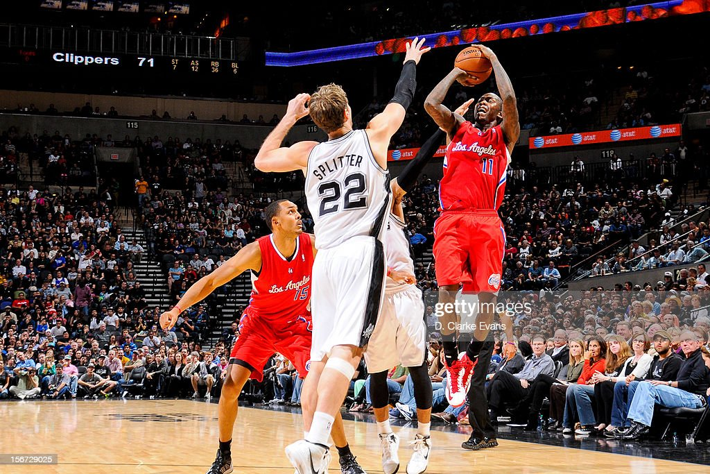 Jamal Crawford #11 of the Los Angeles Clippers shoots against Tiago Splitter #22 of the San Antonio Spurs on November 19, 2012 at the AT&T Center in San Antonio, Texas.