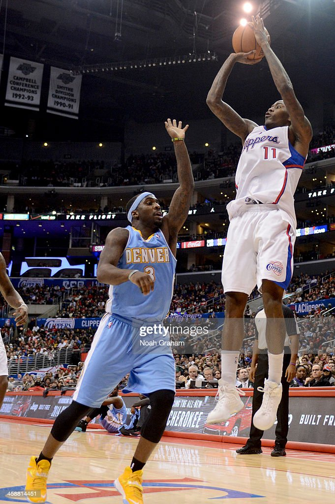 <a gi-track='captionPersonalityLinkClicked' href=/galleries/search?phrase=Jamal+Crawford&family=editorial&specificpeople=201851 ng-click='$event.stopPropagation()'>Jamal Crawford</a> #11 of the Los Angeles Clippers shoots against <a gi-track='captionPersonalityLinkClicked' href=/galleries/search?phrase=Ty+Lawson&family=editorial&specificpeople=4024882 ng-click='$event.stopPropagation()'>Ty Lawson</a> #3 of the Denver Nuggets at STAPLES Center on December 21, 2013 in Los Angeles, California.
