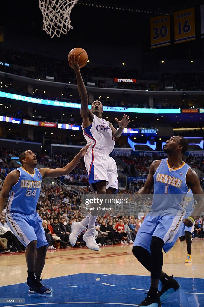 <a gi-track='captionPersonalityLinkClicked' href=/galleries/search?phrase=Jamal+Crawford&family=editorial&specificpeople=201851 ng-click='$event.stopPropagation()'>Jamal Crawford</a> #11 of the Los Angeles Clippers shoots during a game against the Denver Nuggets at STAPLES Center on December 21, 2013 in Los Angeles, California.