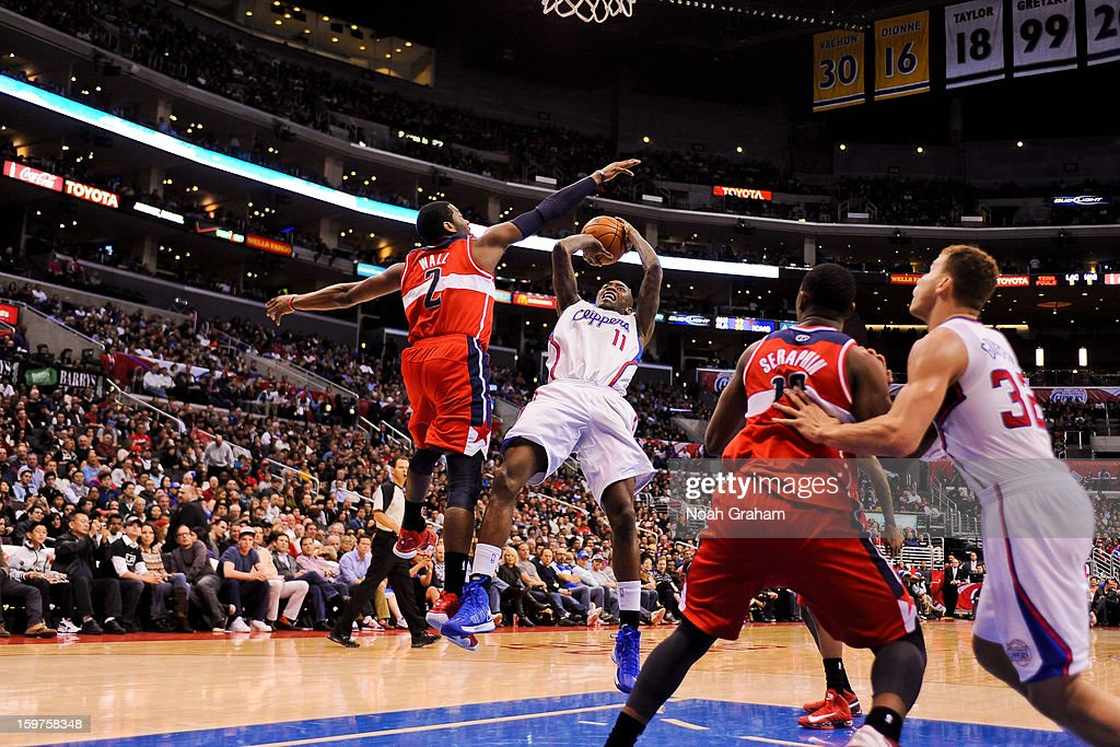 Jamal Crawford #11 of the Los Angeles Clippers shoots in the lane against John Wall #2 of the Washington Wizards at Staples Center on January 19, 2013 in Los Angeles, California.