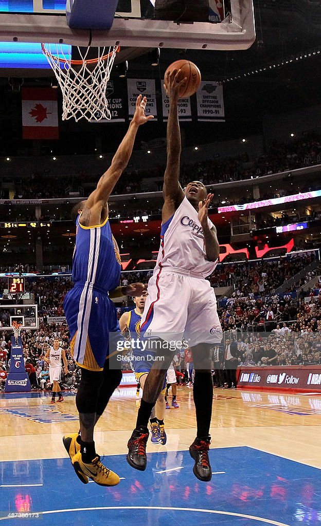 Jamal Crawford #11 of the Los Angeles Clippers shoots over Andre Iguodala #9 of the Golden State Warriors in Game Five of the Western Conference Quarterfinals during the 2014 NBA Playoffs at Staples Center on April 29, 2014 in Los Angeles, California. The Clippers won 113-103.