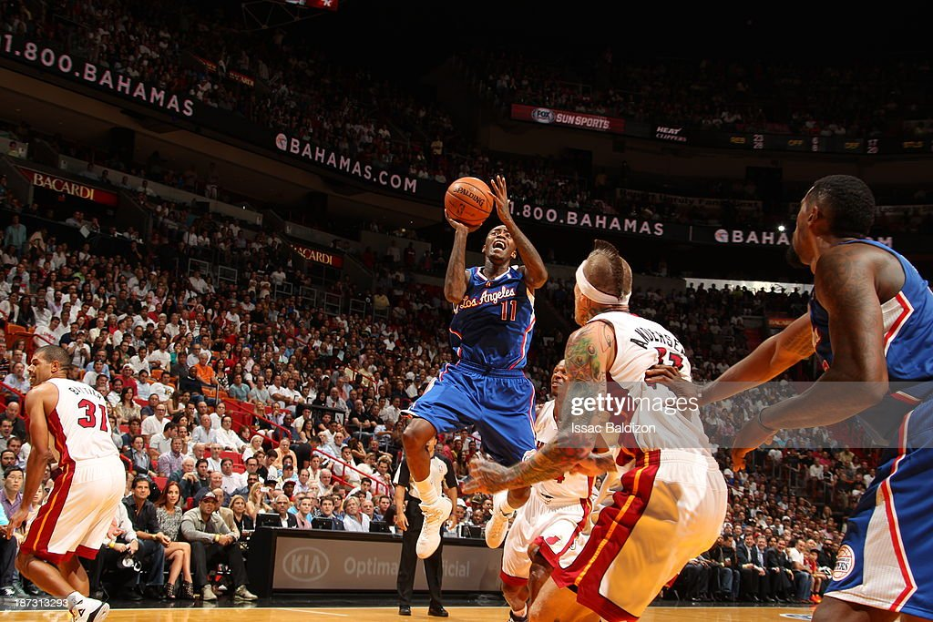 <a gi-track='captionPersonalityLinkClicked' href=/galleries/search?phrase=Jamal+Crawford&family=editorial&specificpeople=201851 ng-click='$event.stopPropagation()'>Jamal Crawford</a> #11 of the Los Angeles Clippers shoots the ball against the Miami Heat on November 7, 2013 at American Airlines Arena in Miami, Florida.