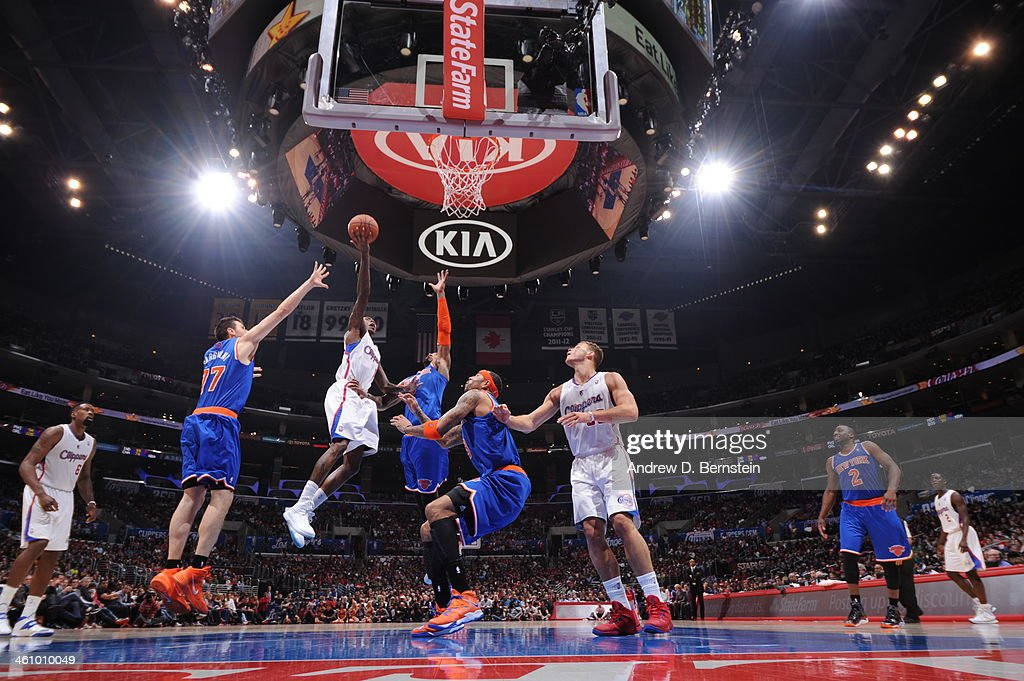 <a gi-track='captionPersonalityLinkClicked' href=/galleries/search?phrase=Jamal+Crawford&family=editorial&specificpeople=201851 ng-click='$event.stopPropagation()'>Jamal Crawford</a> #11 of the Los Angeles Clippers takes a shot against <a gi-track='captionPersonalityLinkClicked' href=/galleries/search?phrase=J.R.+Smith&family=editorial&specificpeople=201766 ng-click='$event.stopPropagation()'>J.R. Smith</a> #8 of the New York Knicks in a game against the New York Knicks at Staples Center on November 27, 2013 in Los Angeles, California.