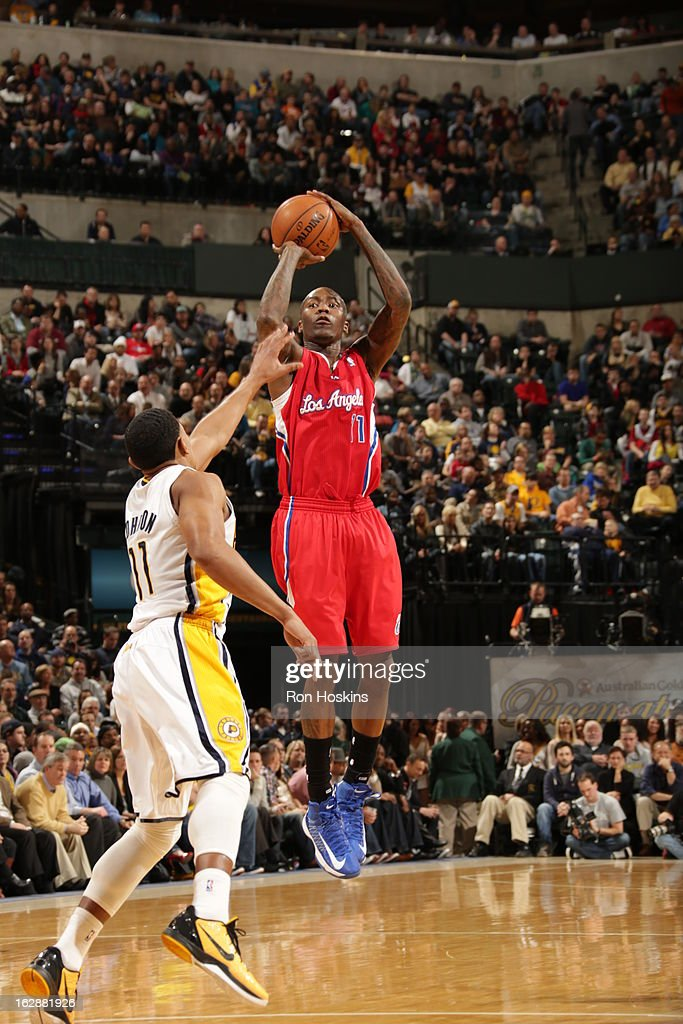 <a gi-track='captionPersonalityLinkClicked' href=/galleries/search?phrase=Jamal+Crawford&family=editorial&specificpeople=201851 ng-click='$event.stopPropagation()'>Jamal Crawford</a> #11 of the Los Angeles Clippers takes a shot against <a gi-track='captionPersonalityLinkClicked' href=/galleries/search?phrase=Orlando+Johnson&family=editorial&specificpeople=6849358 ng-click='$event.stopPropagation()'>Orlando Johnson</a> #11 of the Indiana Pacers on February 28, 2013 at Bankers Life Fieldhouse in Indianapolis, Indiana.