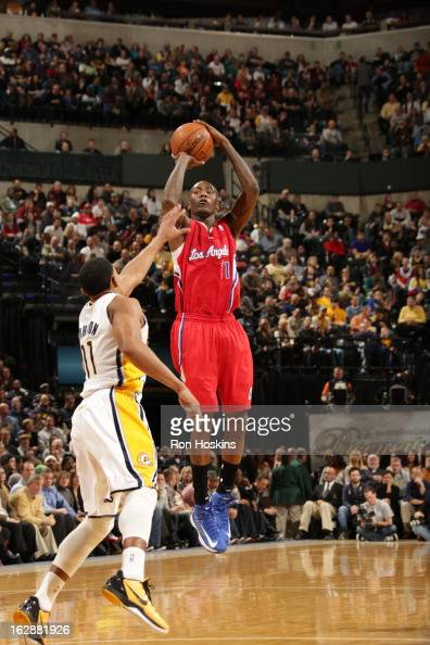 Jamal Crawford of the Los Angeles Clippers takes a shot against Orlando Johnson of the Indiana Pacers on February 28 2013 at Bankers Life Fieldhouse...