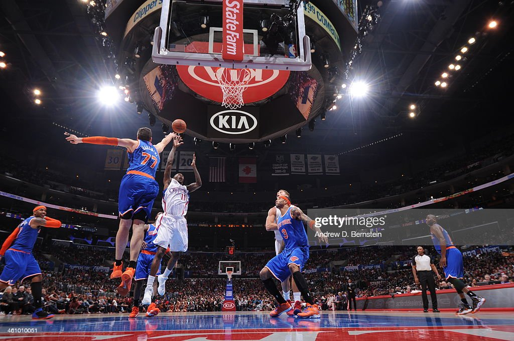 Jamal Crawford #11 of the Los Angeles Clippers takes a shot over Andrea Bargnani #77 of the New York Knicks in a game against the New York Knicks at Staples Center on November 27, 2013 in Los Angeles, California.