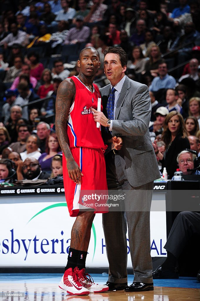 Jamal Crawford #11 of the Los Angeles Clippers talks with Vinny Del Negro during the game against the Charlotte Bobcats on December 12, 2012 at Time Warner Cable Arena in Charlotte, North Carolina.