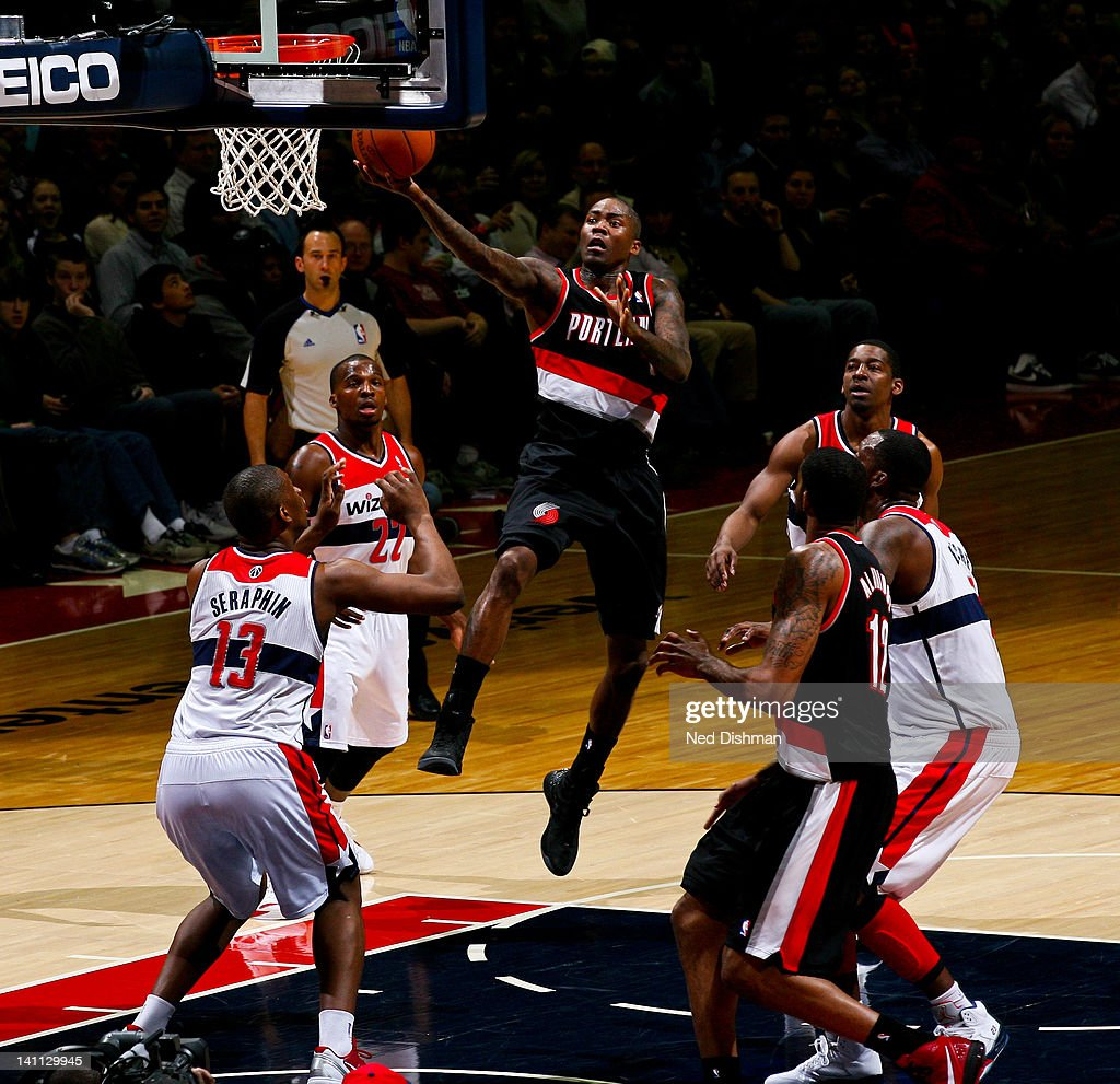 <a gi-track='captionPersonalityLinkClicked' href=/galleries/search?phrase=Jamal+Crawford&family=editorial&specificpeople=201851 ng-click='$event.stopPropagation()'>Jamal Crawford</a> #11 of the Portland Trail Blazers goes to the basket against <a gi-track='captionPersonalityLinkClicked' href=/galleries/search?phrase=Kevin+Seraphin&family=editorial&specificpeople=6474998 ng-click='$event.stopPropagation()'>Kevin Seraphin</a> #13 of the Washington Wizards at the Verizon Center on March 10, 2012 in Washington, DC.