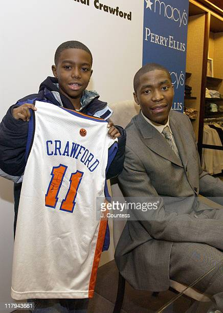 Jamal Crawford poses with DaQuan Merritt during Perry Ellis and Travel Leisure Magazine Host InStore Appearance by NBA Star Jamal Crawford at Macy's...