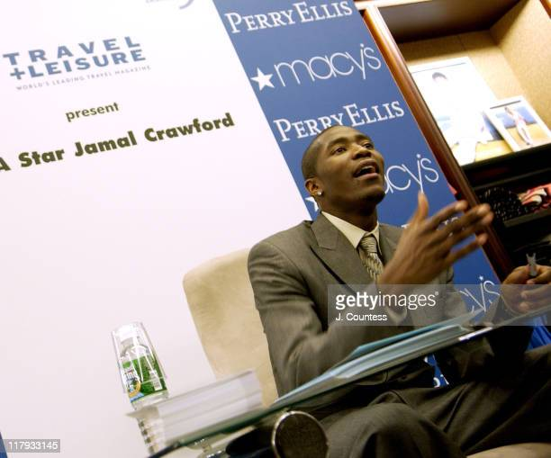 Jamal Crawford signs autographs for fans during Perry Ellis and Travel Leisure Magazine Host InStore Appearance by NBA Star Jamal Crawford at Macy's...
