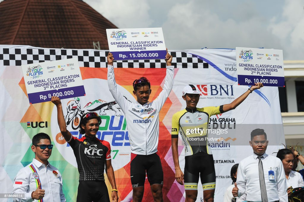Jamal Hibatullah of KFC Cycling Team Indonesia (third), Muh. Imam Arifin of KFC Cycling Team Indonesia (winner), and Hari Fitrianto of CCN Cycling Team Laos (second) celebrate on the podium during Best Indonesian Riders awarding ceremony of the Tour de Flores 2017 on July 19, 2017 in Labuan Bajo, Flores, Indonesia.
