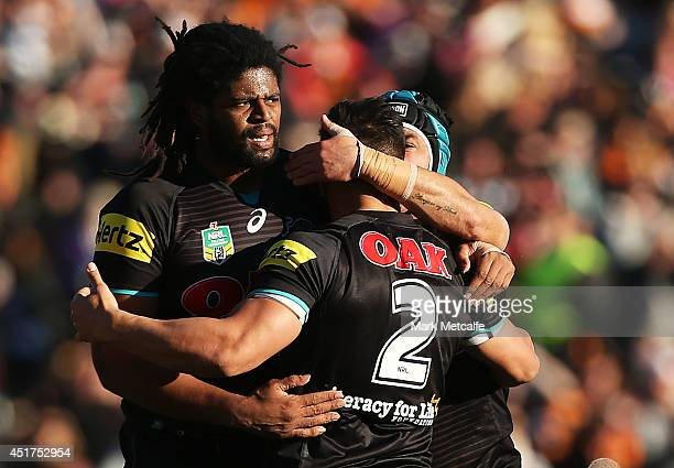 Jamal Idris Josh Mansour and Jamie Soward of the Panthers react to a referee's decision during the round 17 NRL match between the Wests Tigers and...