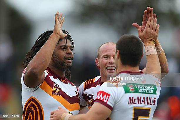 Jamal Idris of Country is congratulated by his team after scoring a try during the Origin match between City and Country at Caltex Park on May 4 2014...