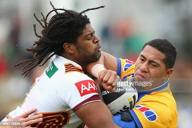 Jamal Idris of Country tackles Jorge Taufua of City during the Origin match between City and Country at Caltex Park on May 4 2014 in Dubbo Australia