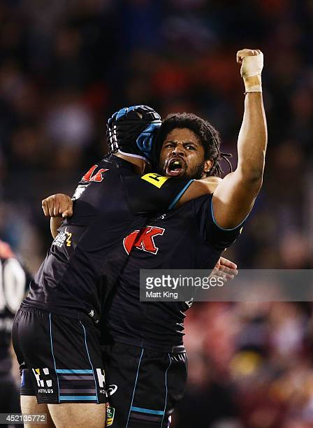 Jamal Idris of the Panthers celebrates victory with Jamie Soward at the end of during the round 18 NRL match between the Penrith Panthers and the...