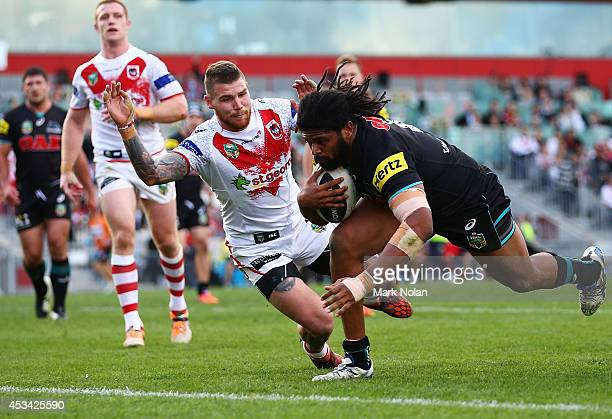 Jamal Idris of the Panthers heads for the try line to score during the round 22 NRL match between the St George Dragons and the Penrith Panthers at...