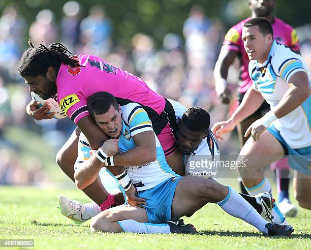 Jamal Idris of the Panthers is tackled by the Titans defence during the round two NRL match between the Penrith Panthers and the Gold Coast Titans at...