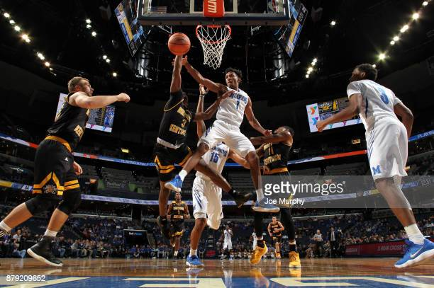 Jamal Johnson of the Memphis Tigers jumps for a rebound against Tre Cobbs of the Northern Kentucky Norse on November 25 2017 at FedExForum in Memphis...