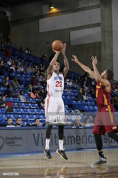Jamal Jones of the Delaware 87ers shoots over Chris Crawford of the Canton Charge at the University of Delaware Bob Carpenter Center on February 24...