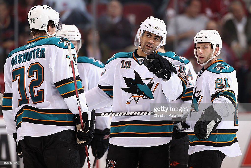 Jamal Mayers and Scott Nichol of the San Jose Sharks talk during the NHL game against the Phoenix Coyotes at Jobingcom Arena on January 17 2011 in...