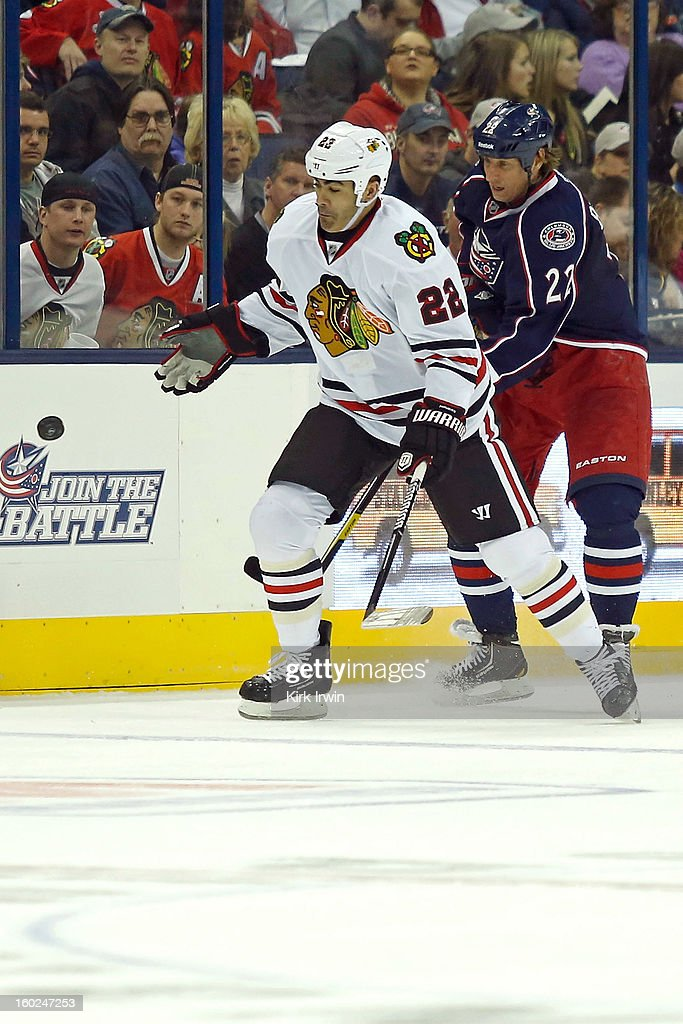 Jamal Mayers #22 of the Chicago Blackhawks and Vinny Prospal #22 of the Columbus Blue Jackets battle for control of a loose puck on January 26, 2013 at Nationwide Arena in Columbus, Ohio. Chicago defeated Columbus 3-2.
